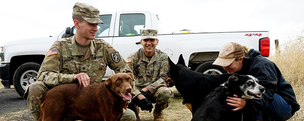 Army Guardsmen with dogs and civilian