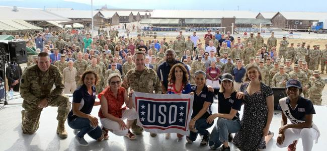 "Army Command Sgt. Maj. Christopher Kepner, senior enlisted advisor to the chief of the National Guard Bureau; Toni Trucks; Sally Lengyel; Air Force Gen. Joseph Lengyel, chief, National Guard Bureau; Quinton ""Rampage"" Jackson; Laura Bryna; Anjelah Johnson; Cassadee Pope; Mayim Bialik; and Nia Franklin pose for a photo after a USO performance, Camp Bondsteel, Kosovo, July 4, 2019. [U.S. Army National Guard photo by Sgt. 1st Class Jim Greenhill]"